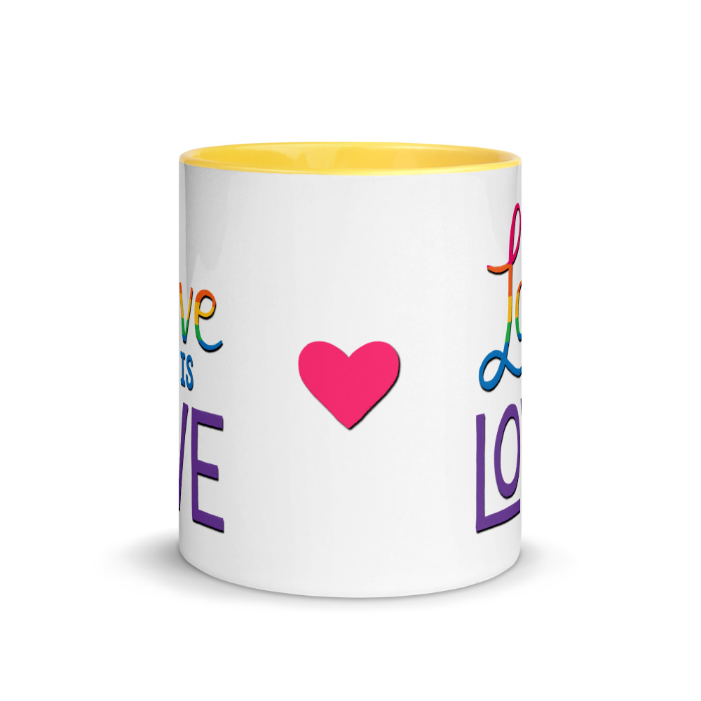 side view of pink heart on love is love mug with yellow handle and inside