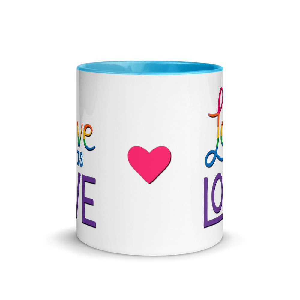 side view of pink heart on love is love mug with blue handle and inside