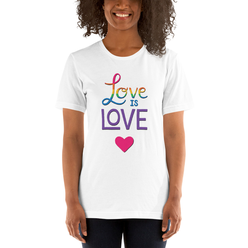 woman wearing a love is love white t-shirt with a pink heart