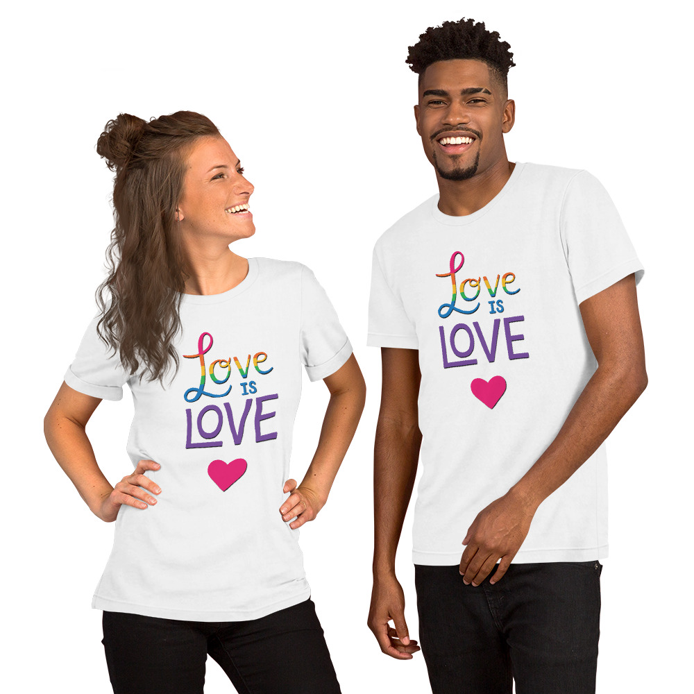couple wearing a love is love white t-shirt with a pink heart