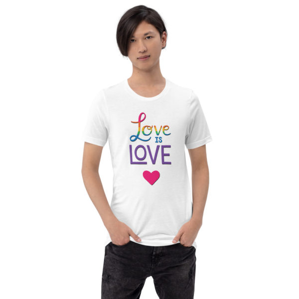 man wearing a love is love white t-shirt with a pink heart