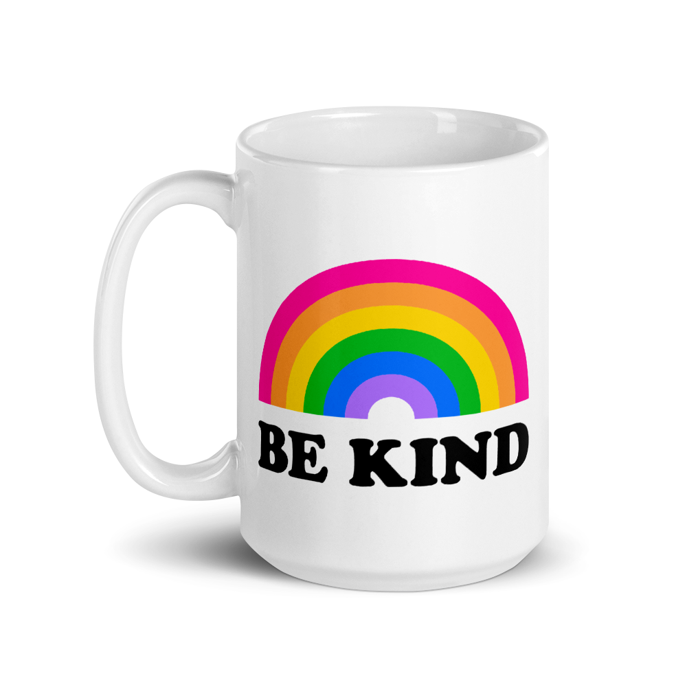 lgbt tall white mug with text that says be kind and a rainbow above it