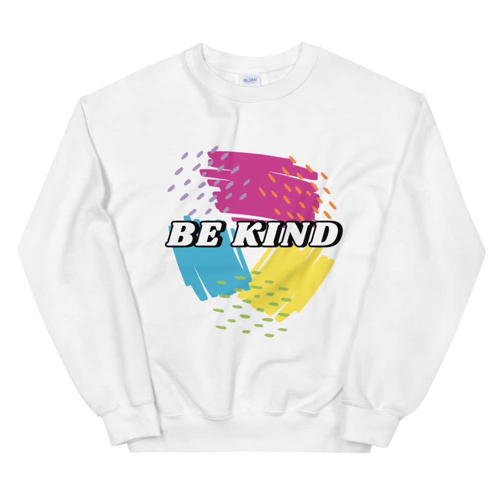 white sweatshirt with pink, yellow, and blue scribbles that says be kind