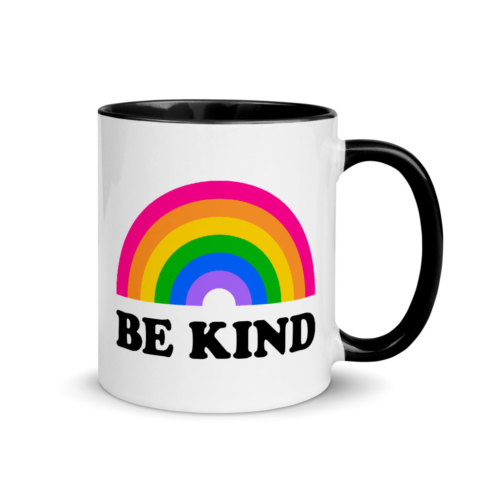 white mug with black inside and rim. the design says be kind with a rainbow above it