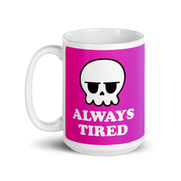 a white mug with a pink gradient background and it says always tired with a grumpy skull